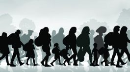 idący imigranci